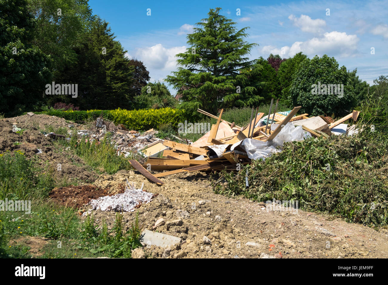 builders Rubbish rubble tipped on rural land kent eyesore countryside dumping - Stock Image