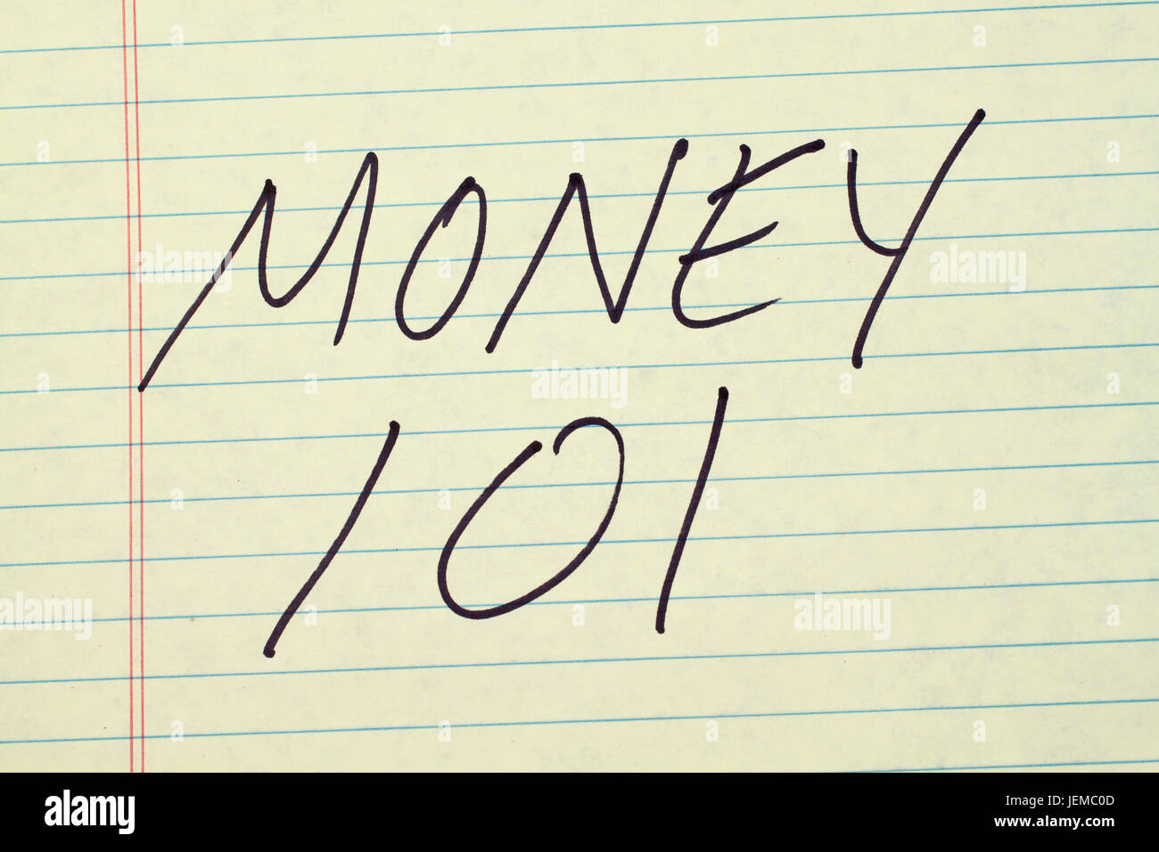 The words 'Money 101' on a yellow legal pad - Stock Image