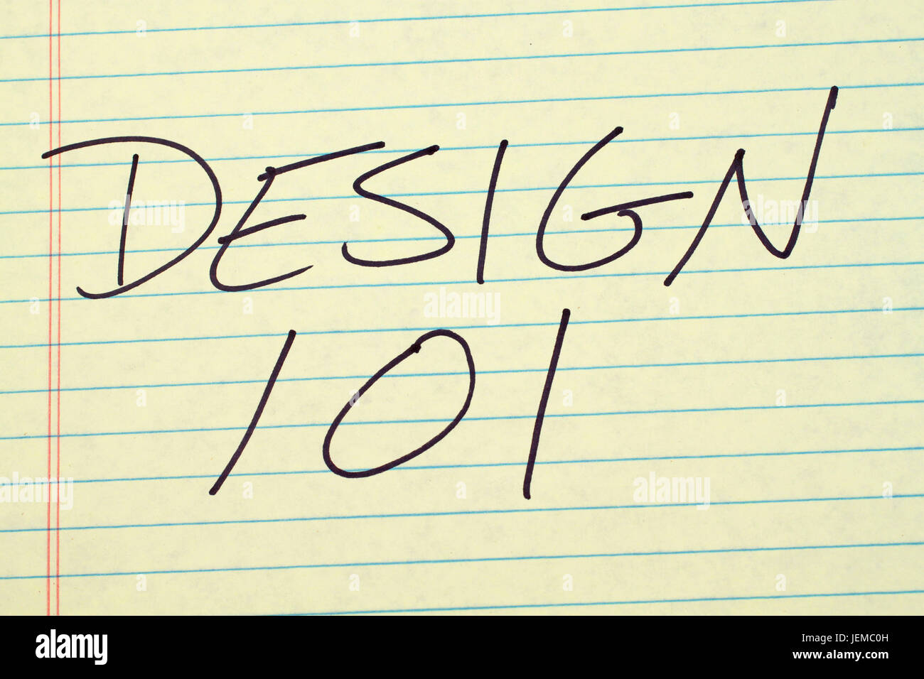 The words 'Design 101' on a yellow legal pad - Stock Image