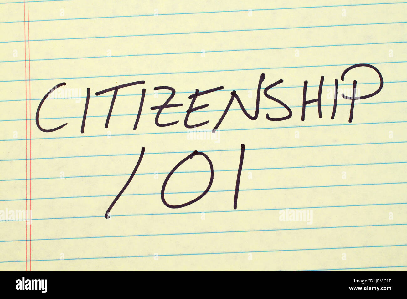 The words 'Citizenship 101' on a yellow legal pad - Stock Image