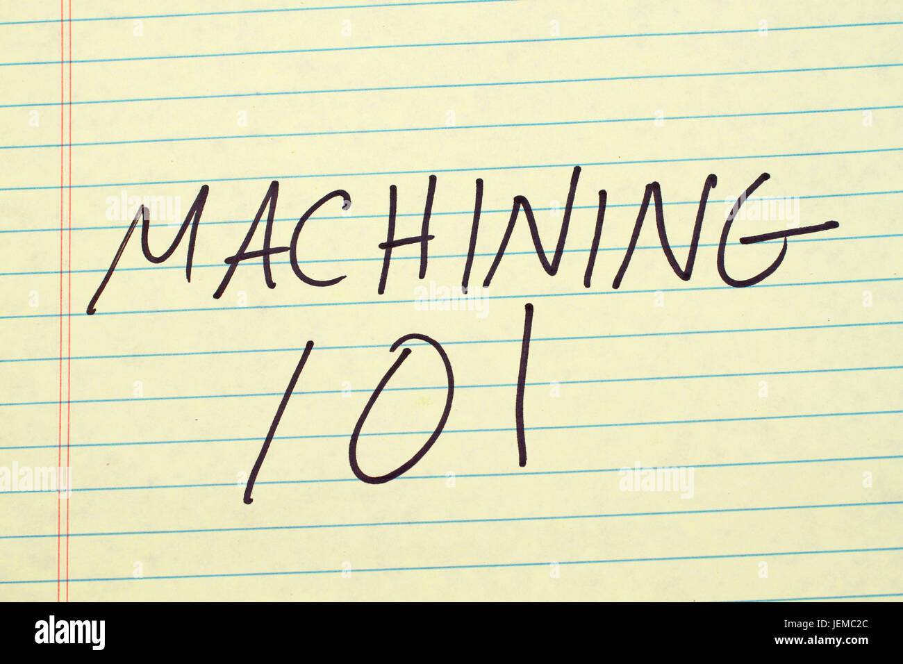 The words 'Machining 101' on a yellow legal pad - Stock Image