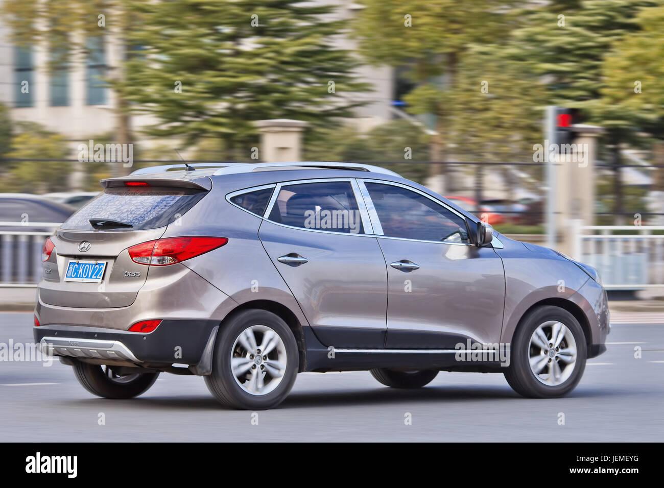 Beige Hyundai IX 35 SUV on the street. Hyundai car sales in China increased 11.2 percent in 2015, keeping an upward - Stock Image