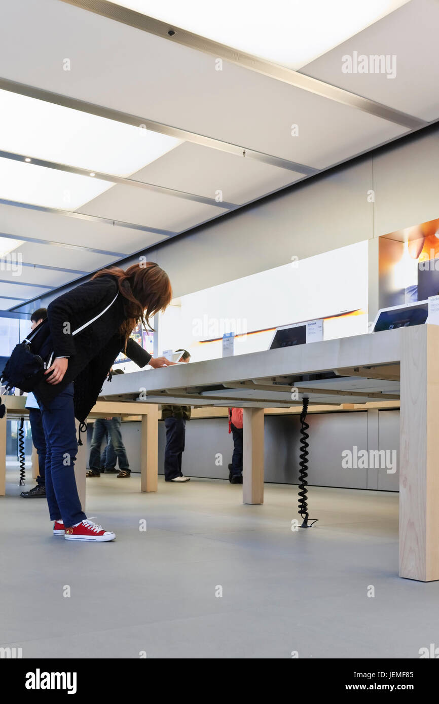 Interior of Apple flagship store, Beijing. Apple is an iconic brand in China and speaks to the imagination of its - Stock Image