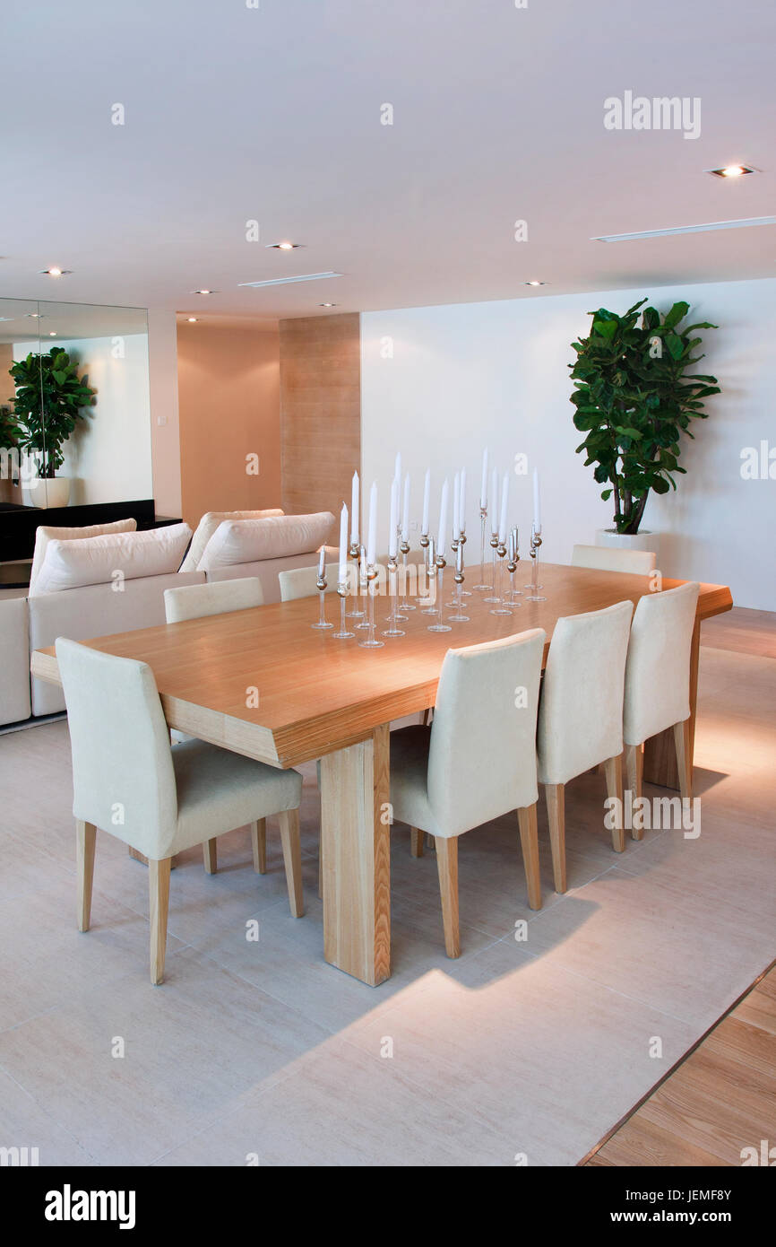 Living room of a luxury model apartment wit a large table and chairs breaching an atmosphere of wealth and taste. - Stock Image