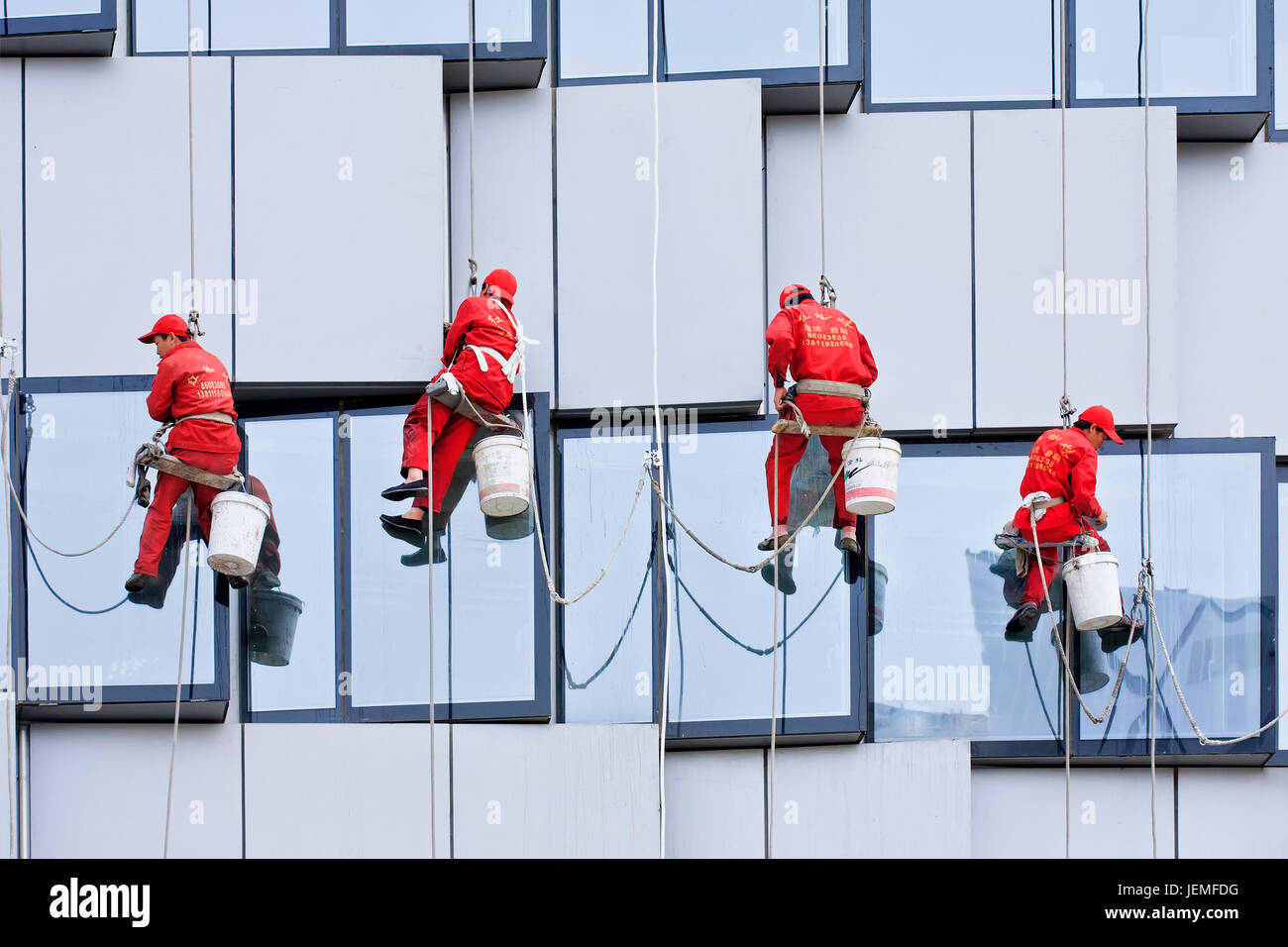 BEIJING - APRIL 28, 2009. Window cleaners at work. They are known as spider-men because they entrust their lives - Stock Image