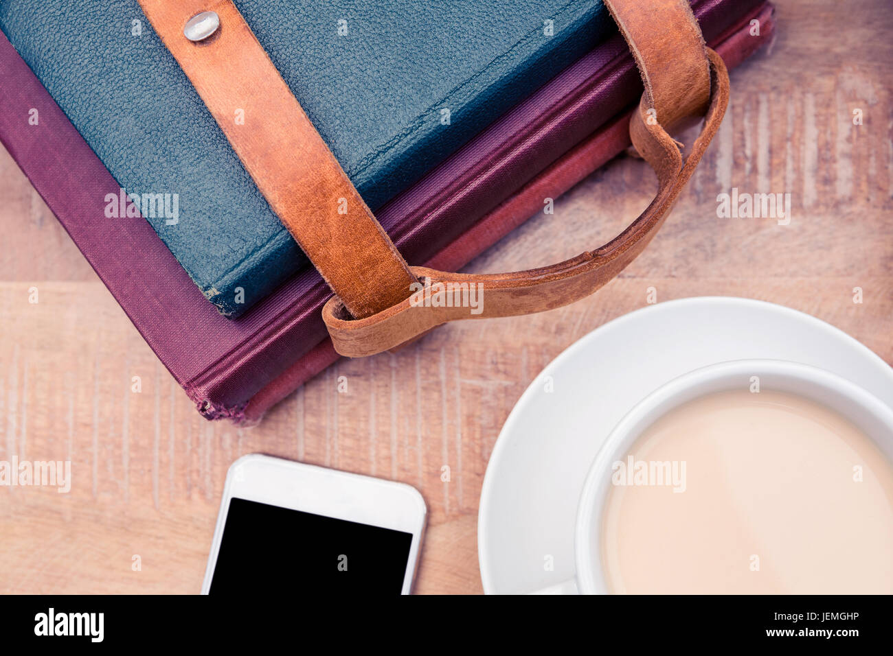 Coffee with smartphone and diaries - Stock Image