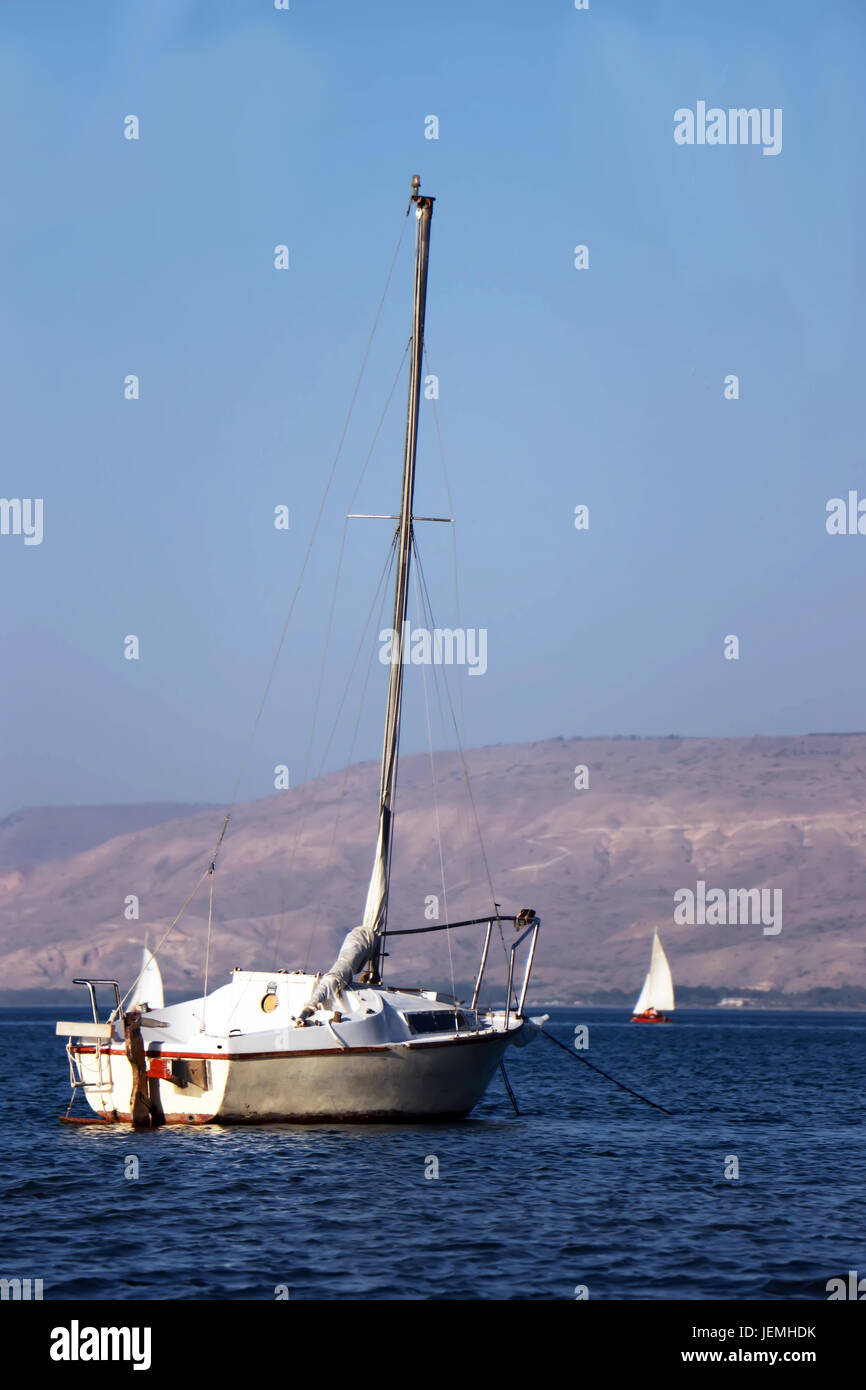 Sailboat with a lowered sail - Stock Image