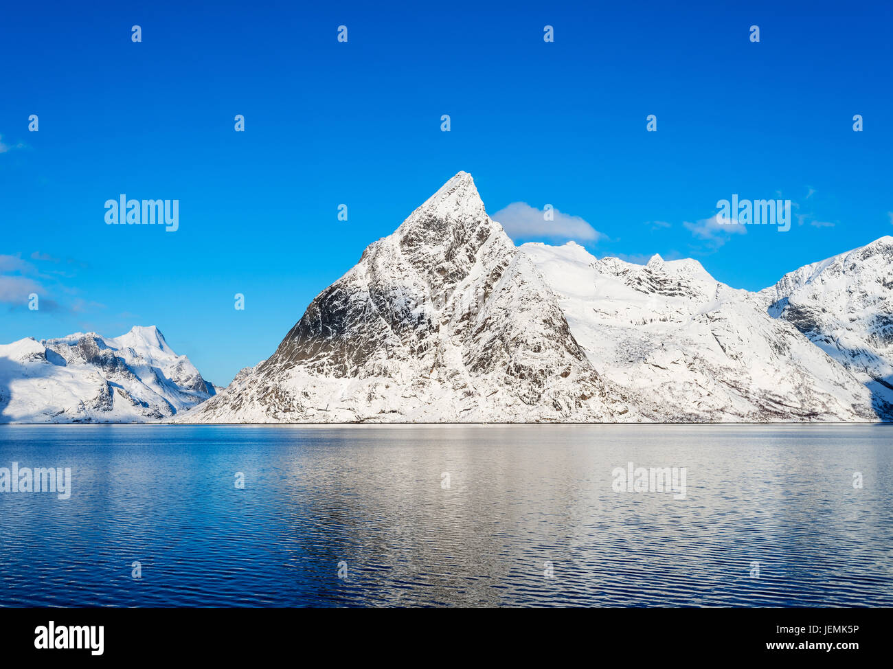 Mount Olstind reflected in the calm waters of Reinefjord on the Lofoten Islands Stock Photo