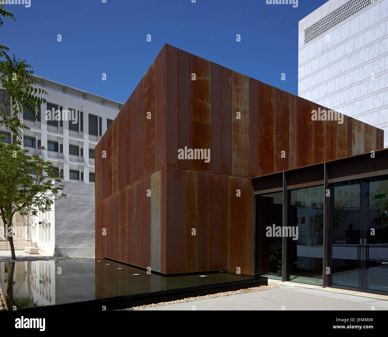 Side view showing Corten steel cube over water feature