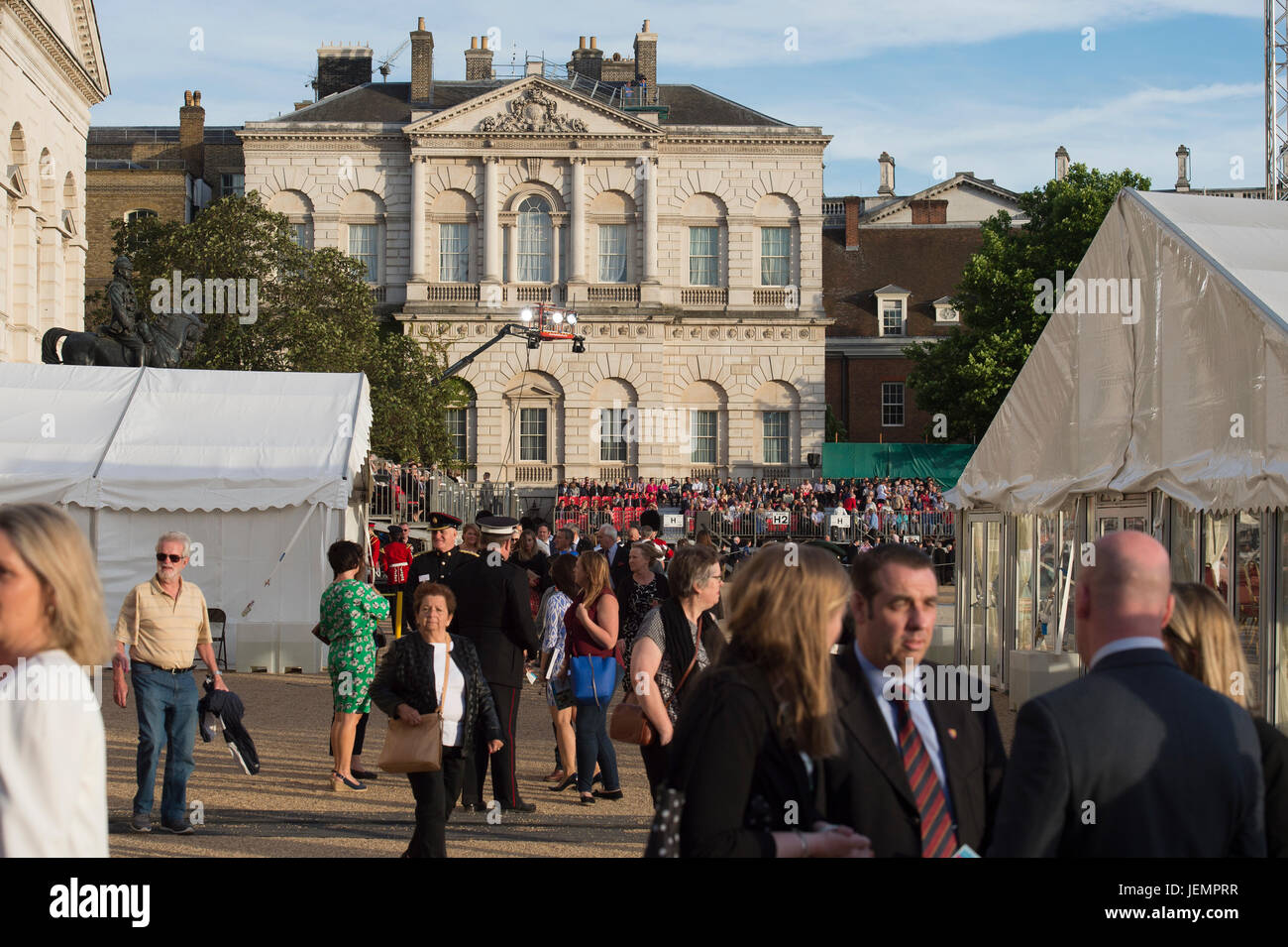 Guests arrive on Horse Guards Parade for the evening spectacle of Beating Retreat, an annual summer military show - Stock Image