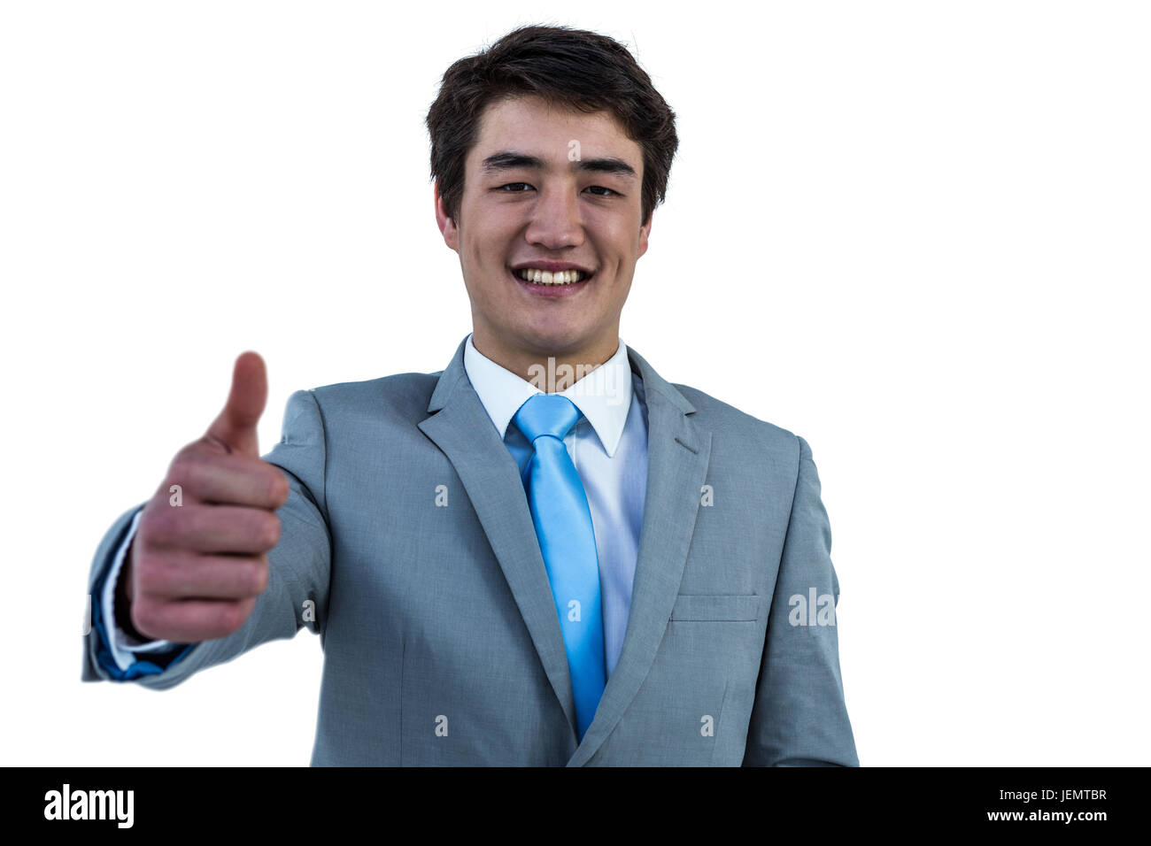 Smiling asian businessman showing thumbs up Stock Photo