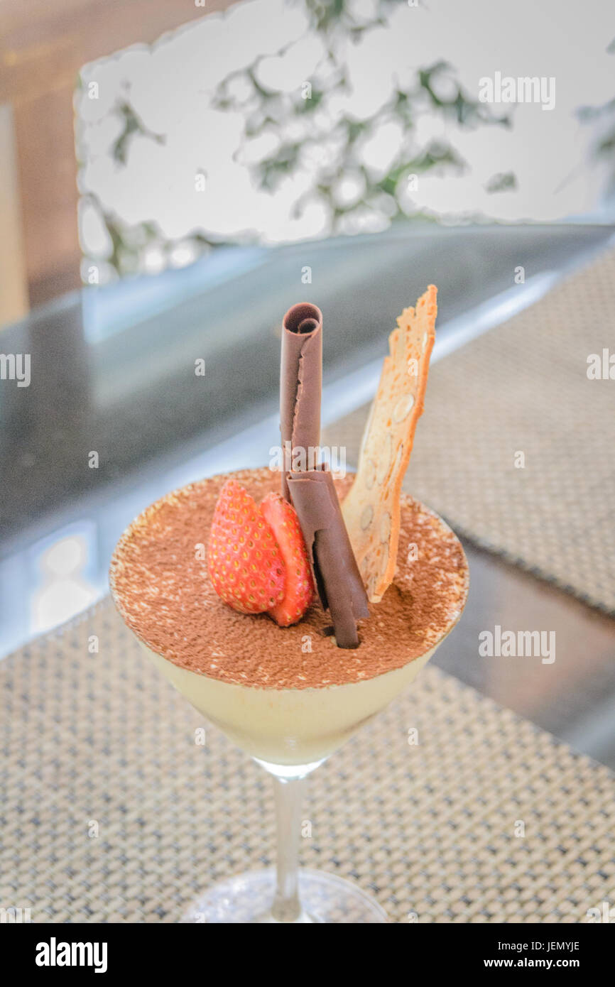 Tiramisu rich mascarpone cream with coffee infused 'lady-fingers' dusted with cocoa powder, shaved chocolate - Stock Image
