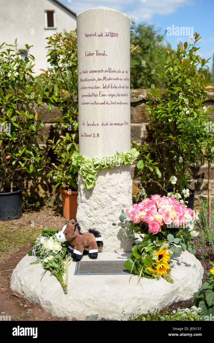 The newly unveiled memorial in honour of Pascal, a child who went missing sixteen years ago, in the Catholic cemetery - Stock Image