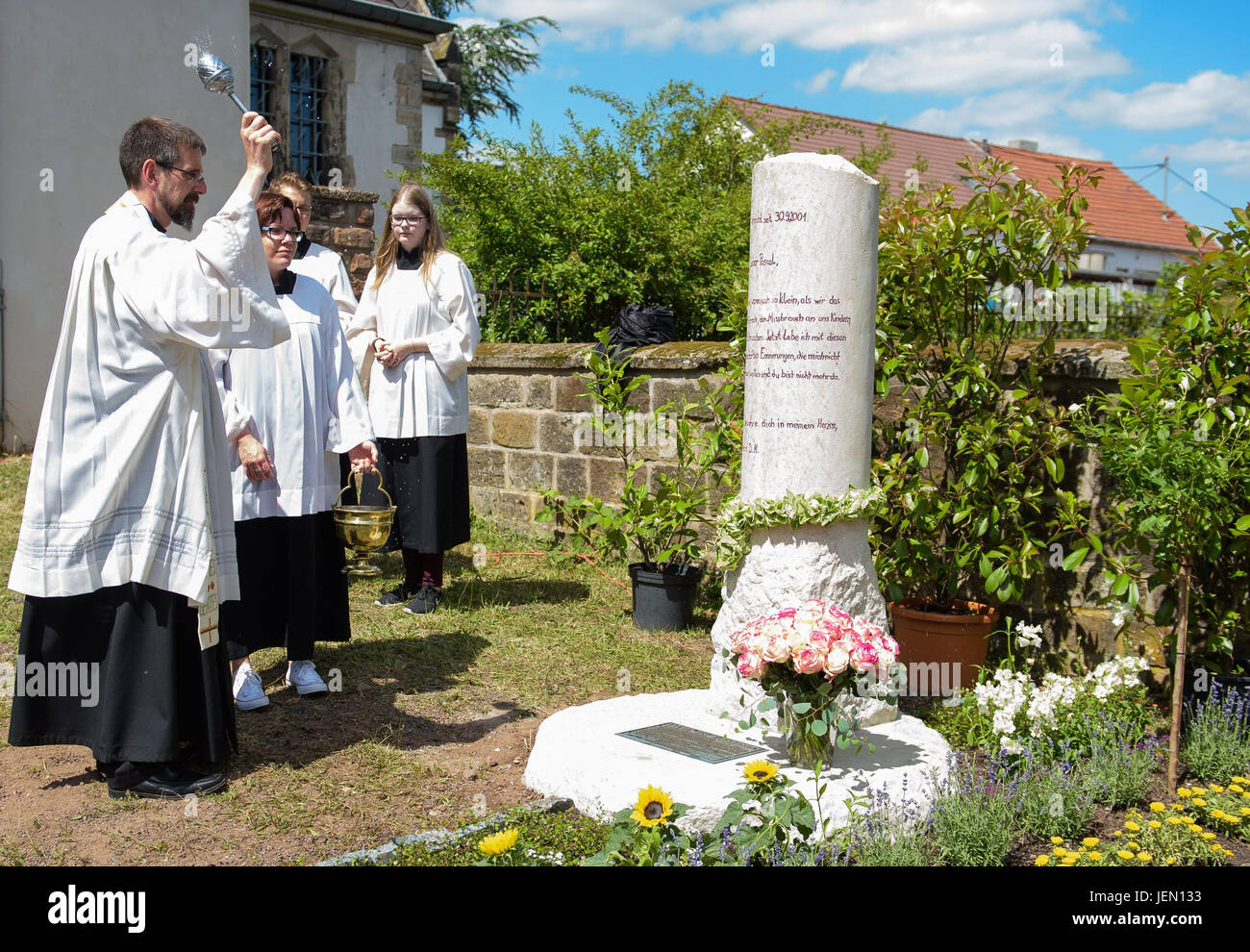 Priest Heinz-Georg Mueller blesses a memorial in honour of Pascal, a child who went missing sixteen years ago, in - Stock Image