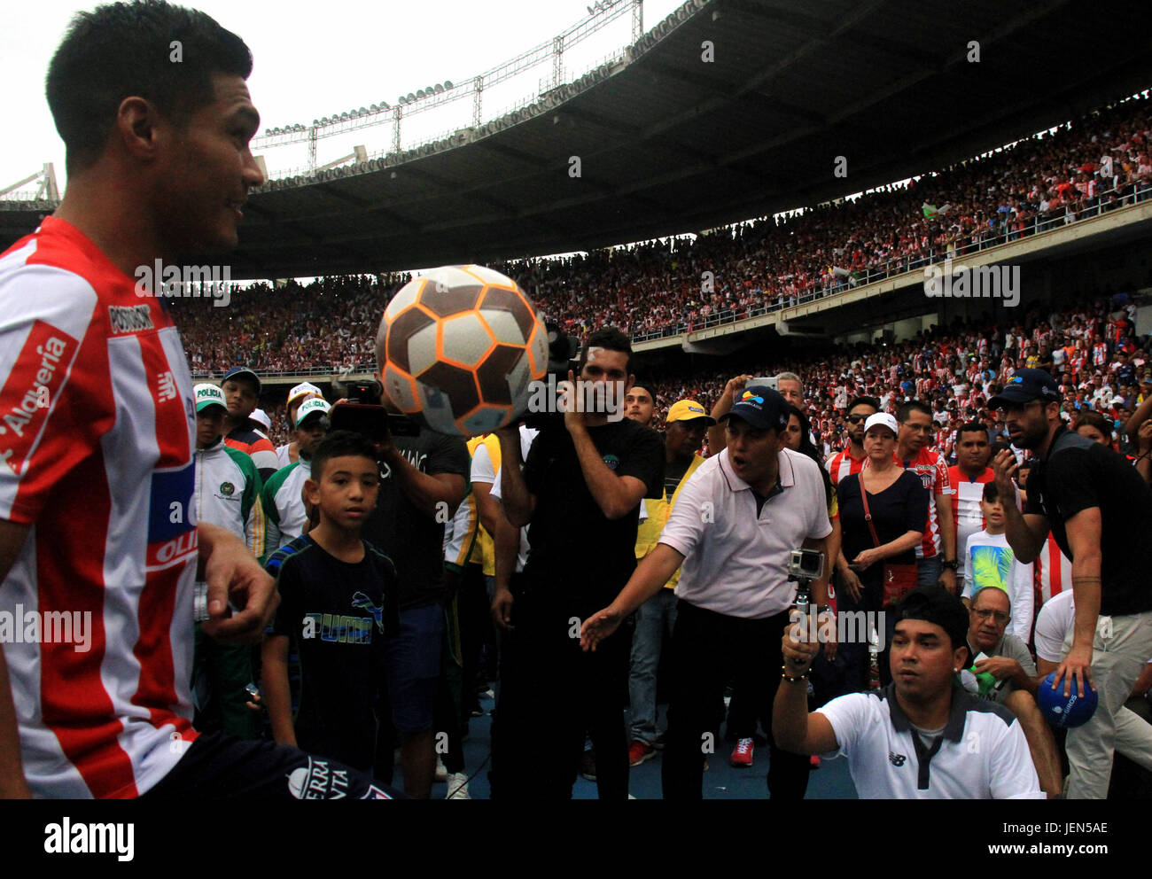 Colombian soccer player Teoilo Gutierrez (L) maneuvers the ball before the fans and the media at Metropolitano Roberto - Stock Image