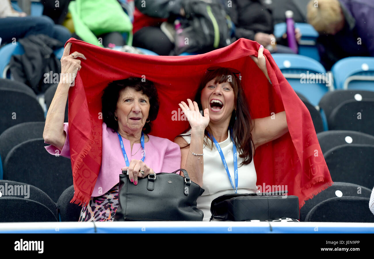 Eastbourne, Sussex, UK. 27th June 2017. These ladies look happy despite the rain stopping play at the Aegon International Stock Photo