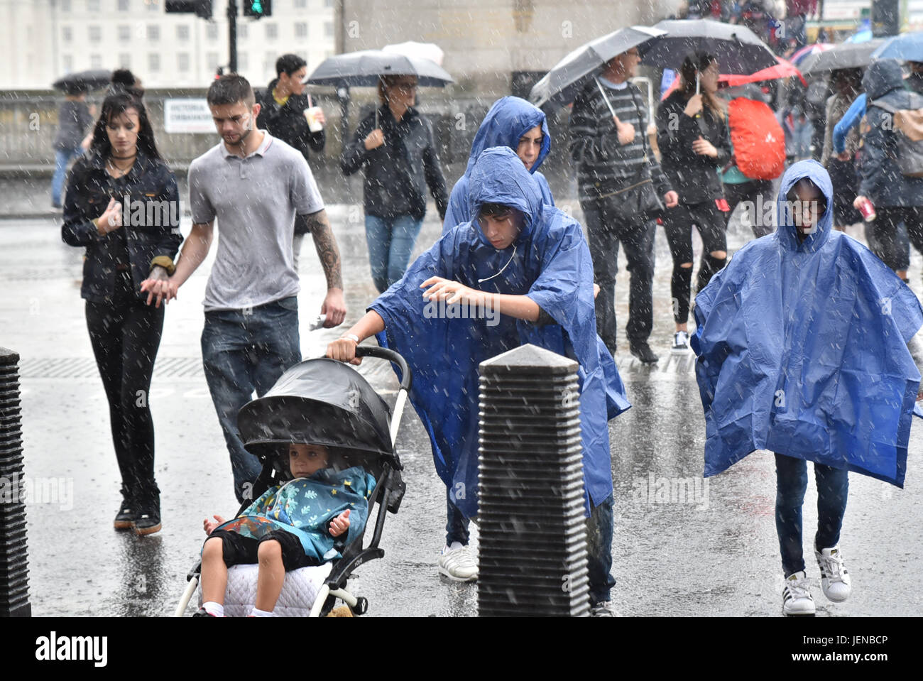 Parliament, London, UK. 27th June, 2017. A heavy downpour of rain near Parliament. Credit: Matthew Chattle/Alamy Stock Photo