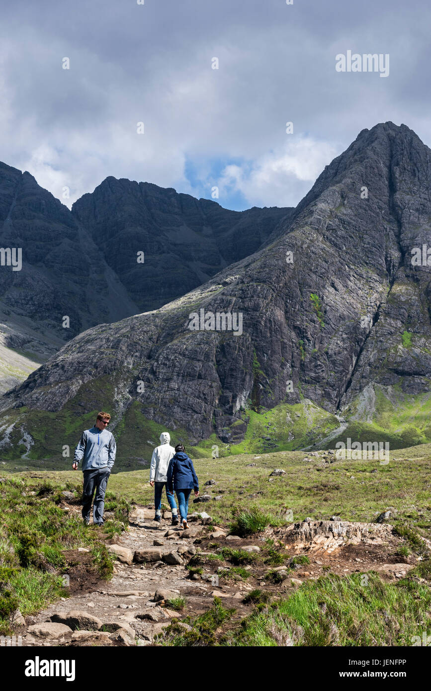 Walkers following path in Glen Brittle towards the mountain Black Cuillin on the Isle of Skye, Scottish Highlands, - Stock Image