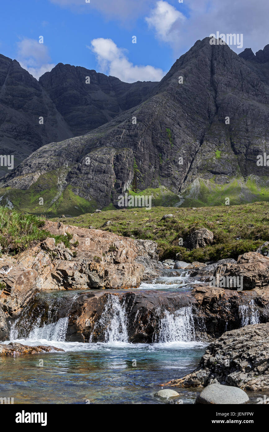 Waterfall of the Fairy Pools in front of the Black Cuillin in Glen Brittle on the Isle of Skye, Scottish Highlands, Stock Photo