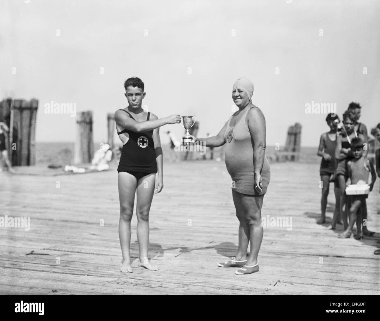 Two Swimmers Holding Trophy, Harris & Ewing, 1927 Stock Photo