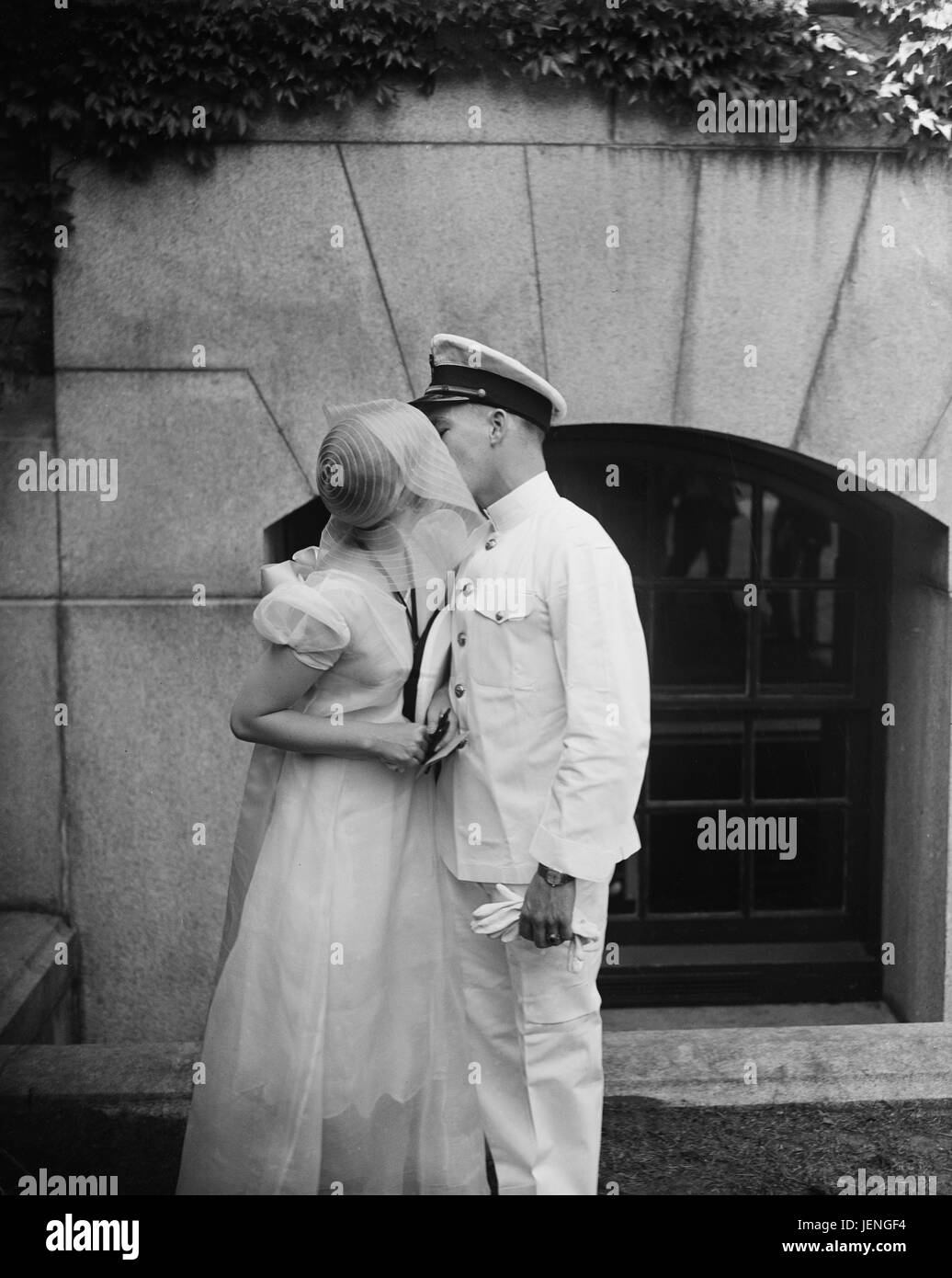Naval Couple Kissing, U.S. Naval Academy, Annapolis, Maryland, USA, Harris & Ewing, May 1930 - Stock Image