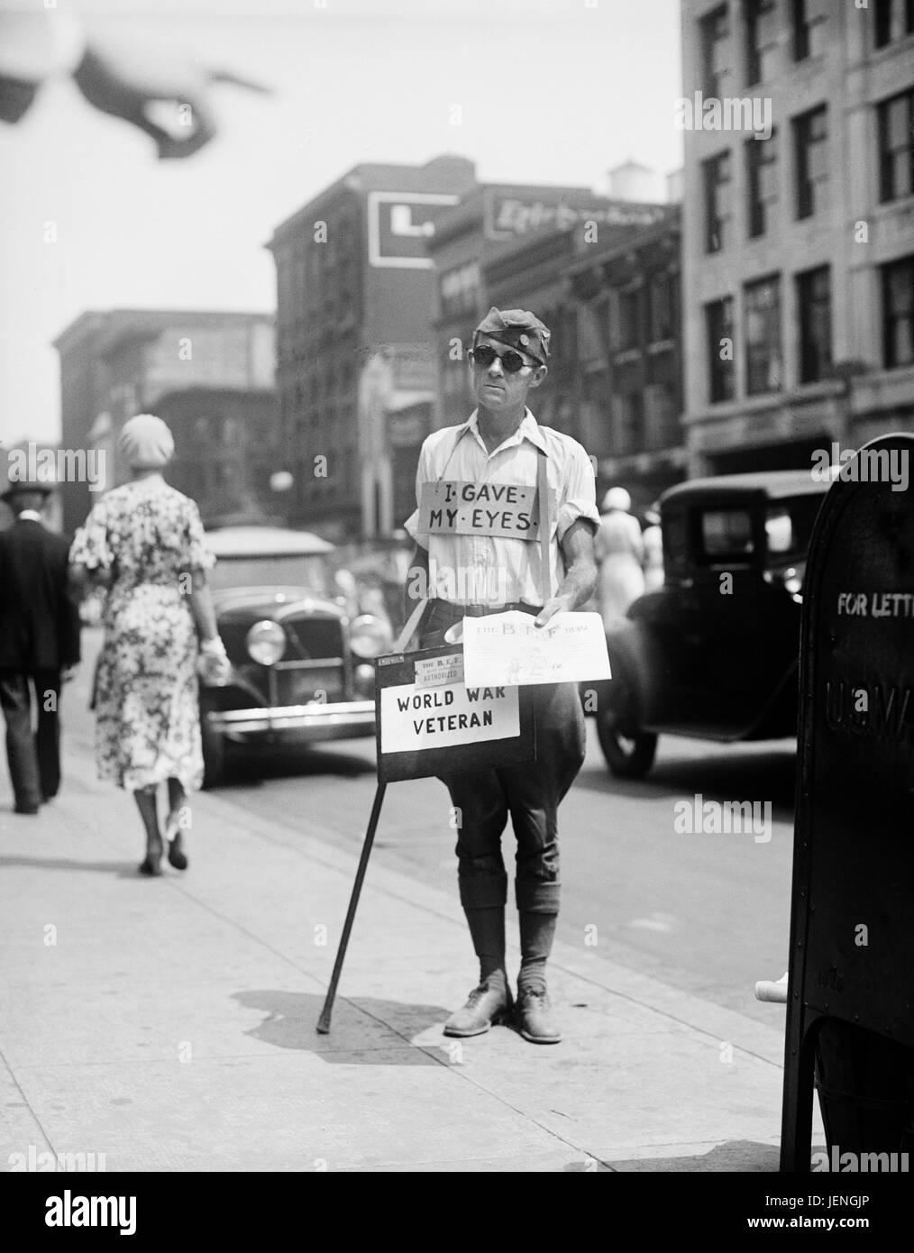 Blind World War I Veteran Selling Newspapers on Sidewalk, Washington DC, USA, 1933 - Stock Image
