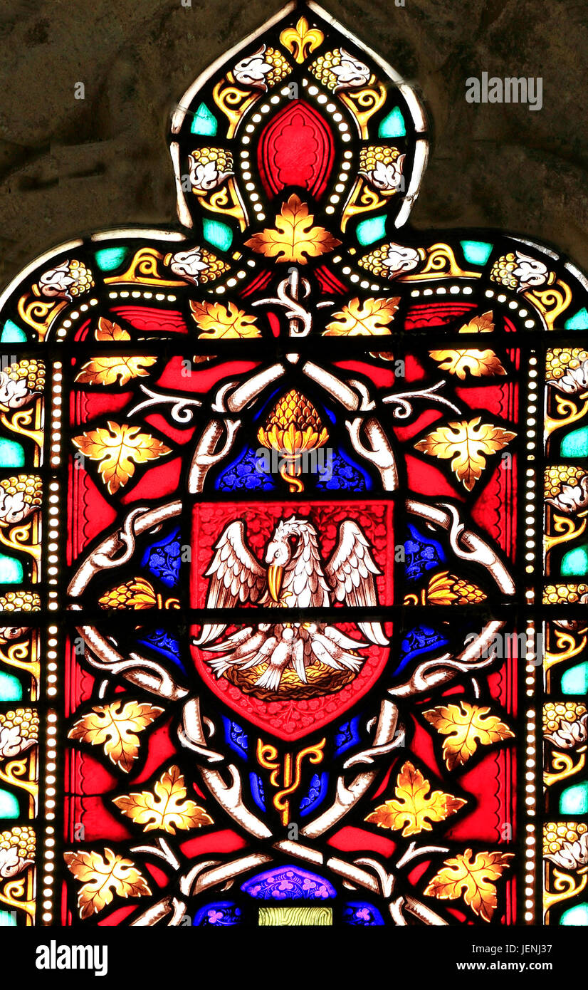 Pelican in her Piety, Christian symbol, Redeemer, stained glass window by William Warrington, 1856, Field Dalling, Stock Photo