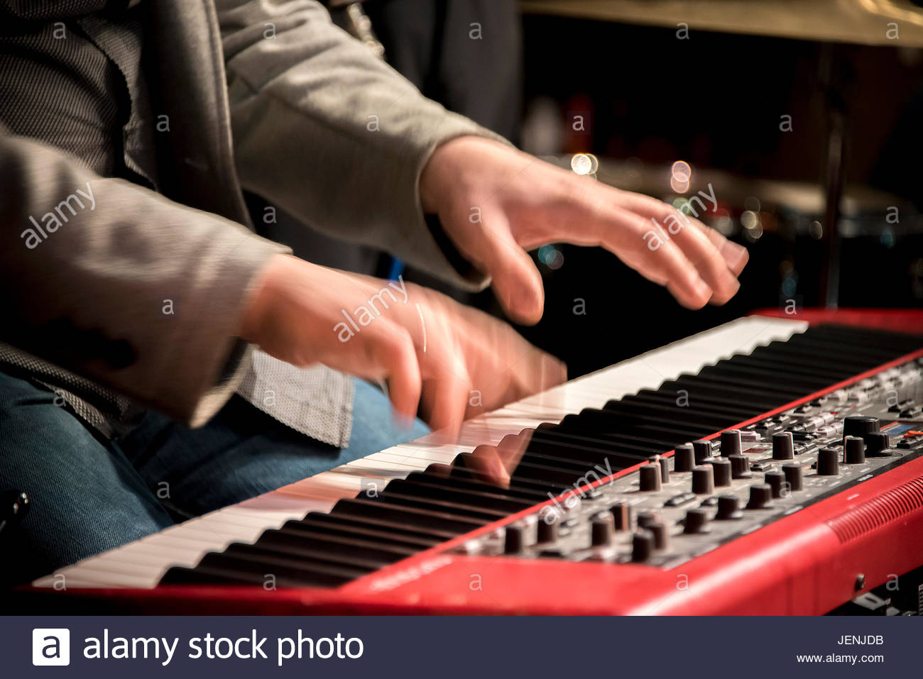 Hands of musician playing keyboard, musical instrument, synthesizer, concert - Stock Image