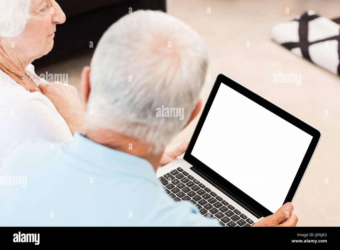 Focused senior couple using laptop Stock Photo