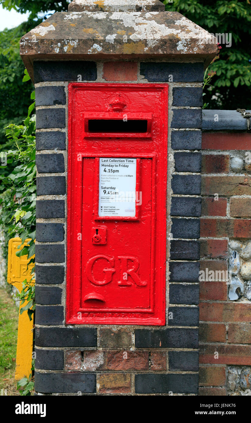 English Red Letter Box, GR Royal Cypher, George Vth, village post box, early 20th century, wall inserted, Saxlingham, - Stock Image