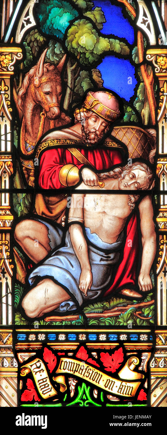 Good Samaritan Parable, tending traveller's injuries, giving water, 'He had compassion on him', stained - Stock Image