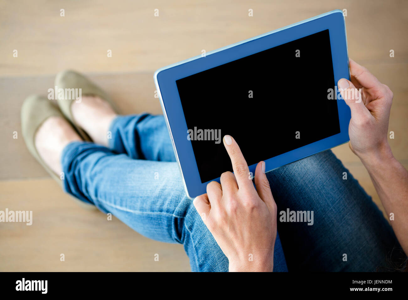 finger tapping a touchscreen tablet - Stock Image