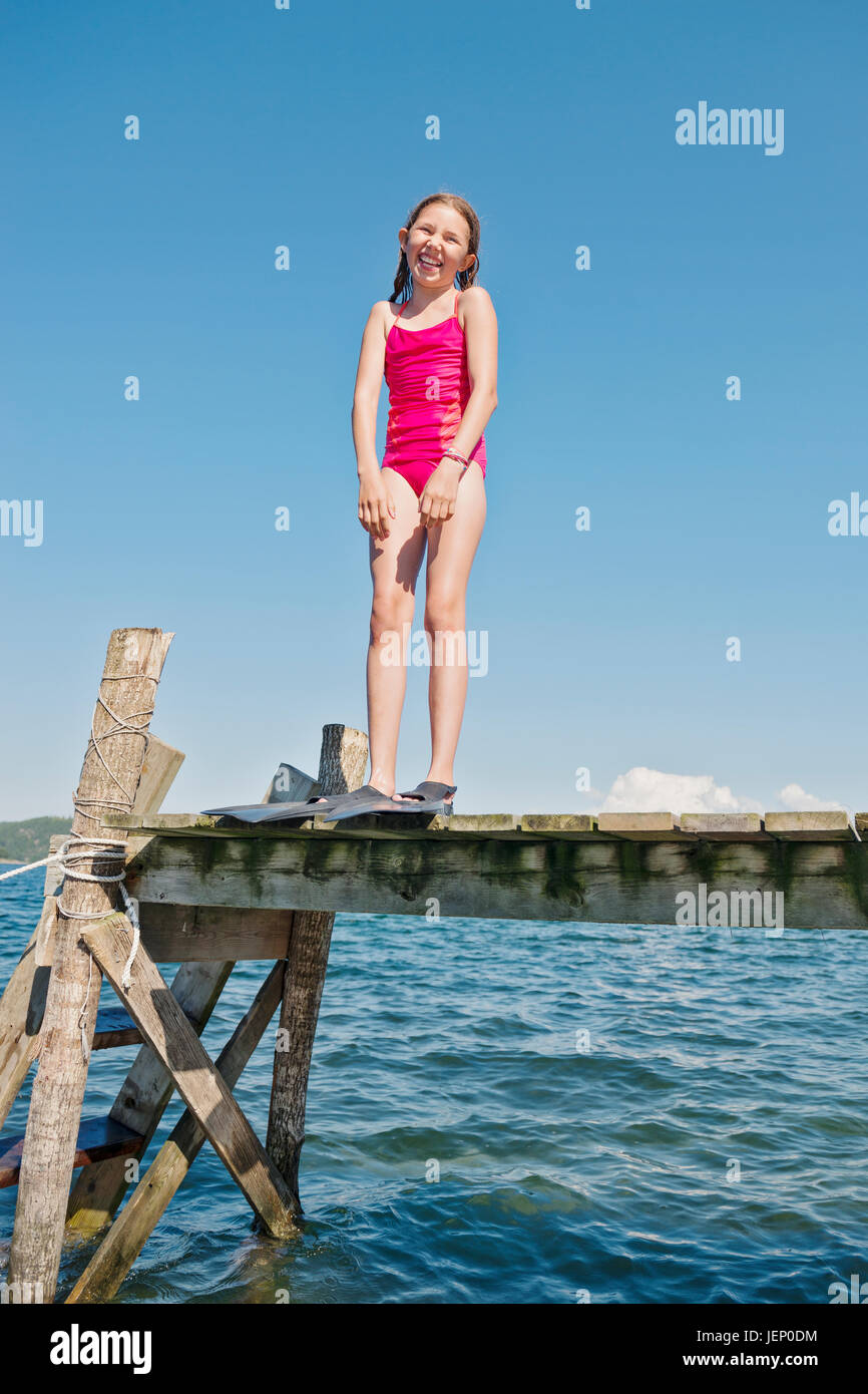girl wearing flippers on jetty Stock Photo