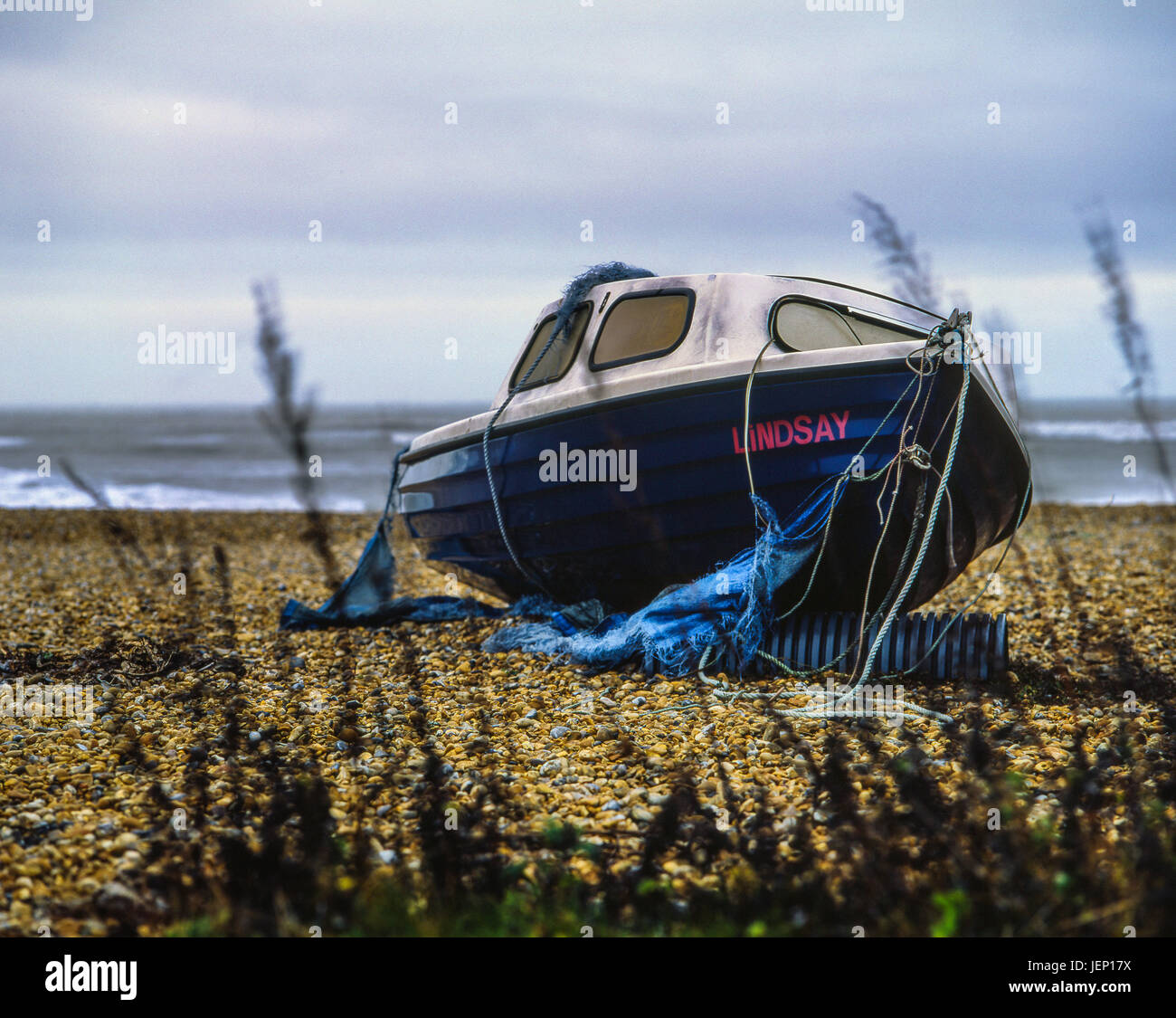Boat left abandoned on beach, photographed with a Mamiya