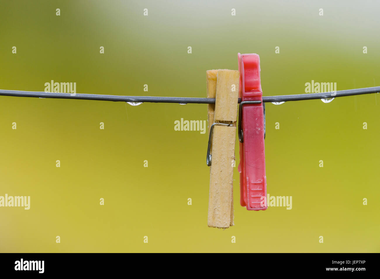 Clothes pegs on line - Stock Image