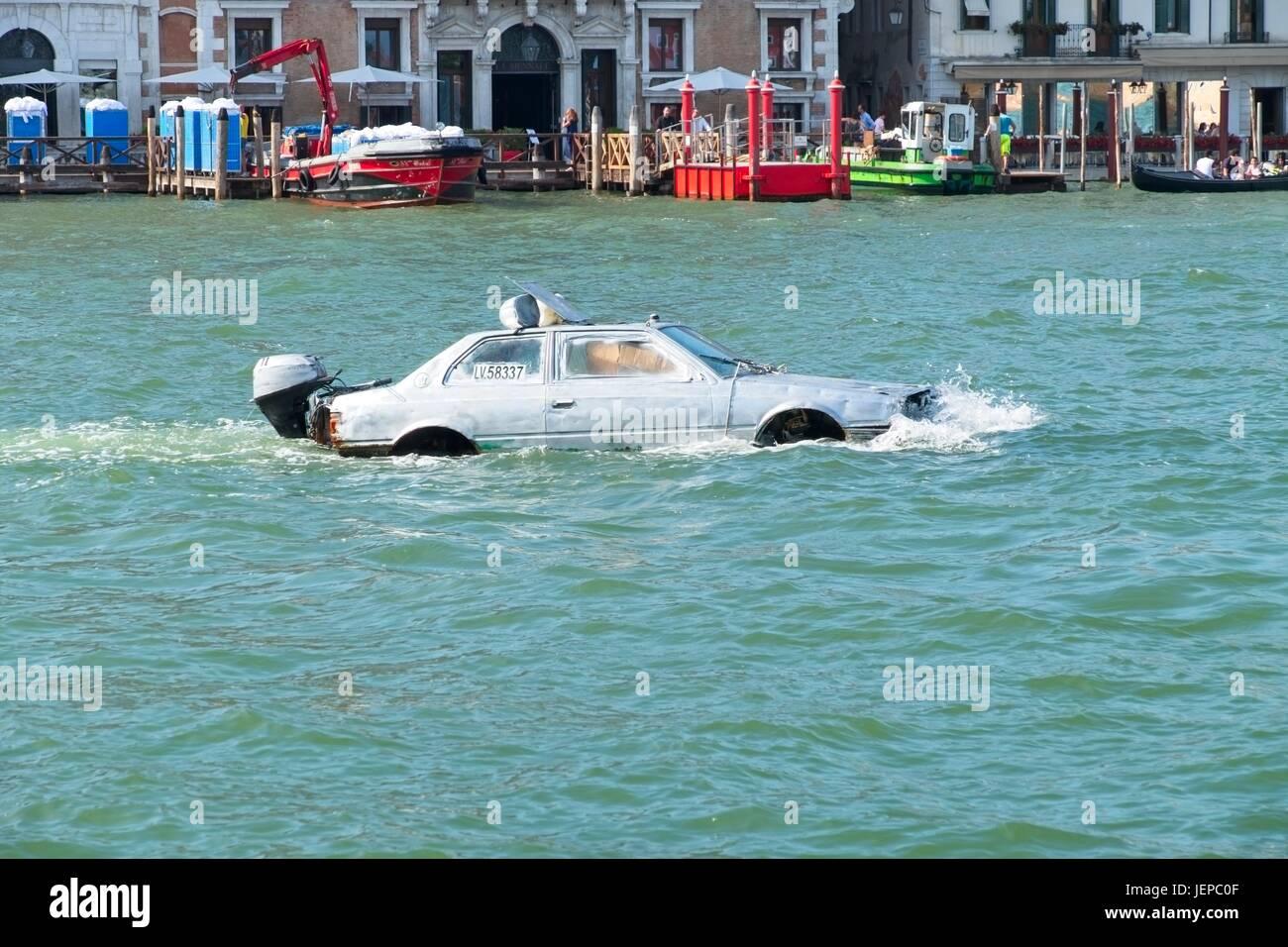 Venezia Veneto Italia. Marco Amoretti Maserati biturbo auto boat in the Gran Canal. This modified car was used to - Stock Image