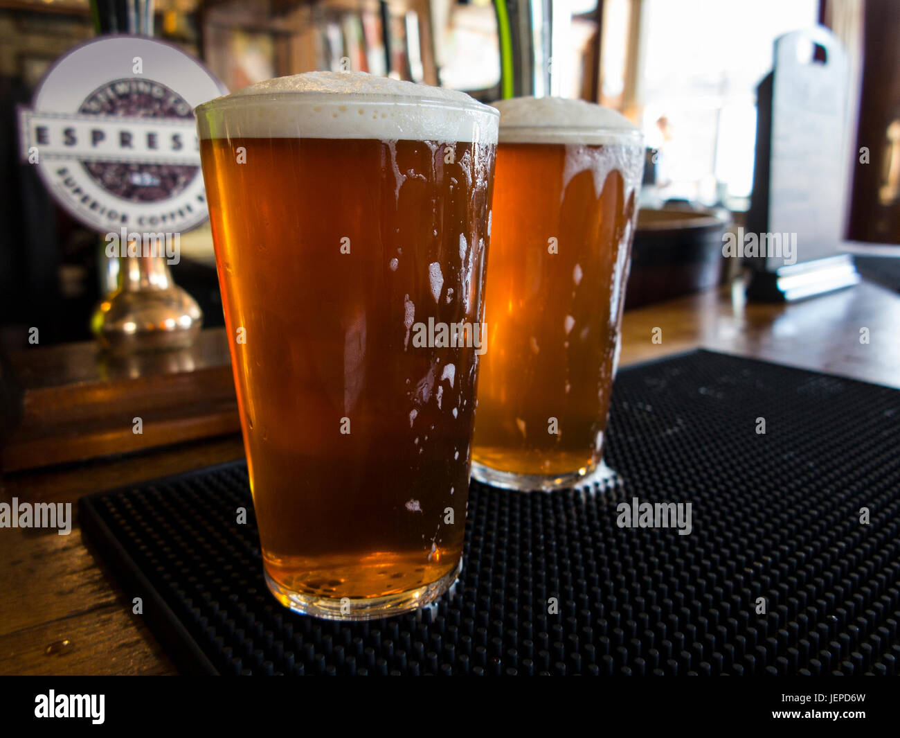 TWO PINTS OF BITTER AWAIT DRINKING IN A LONDON PUB Stock Photo