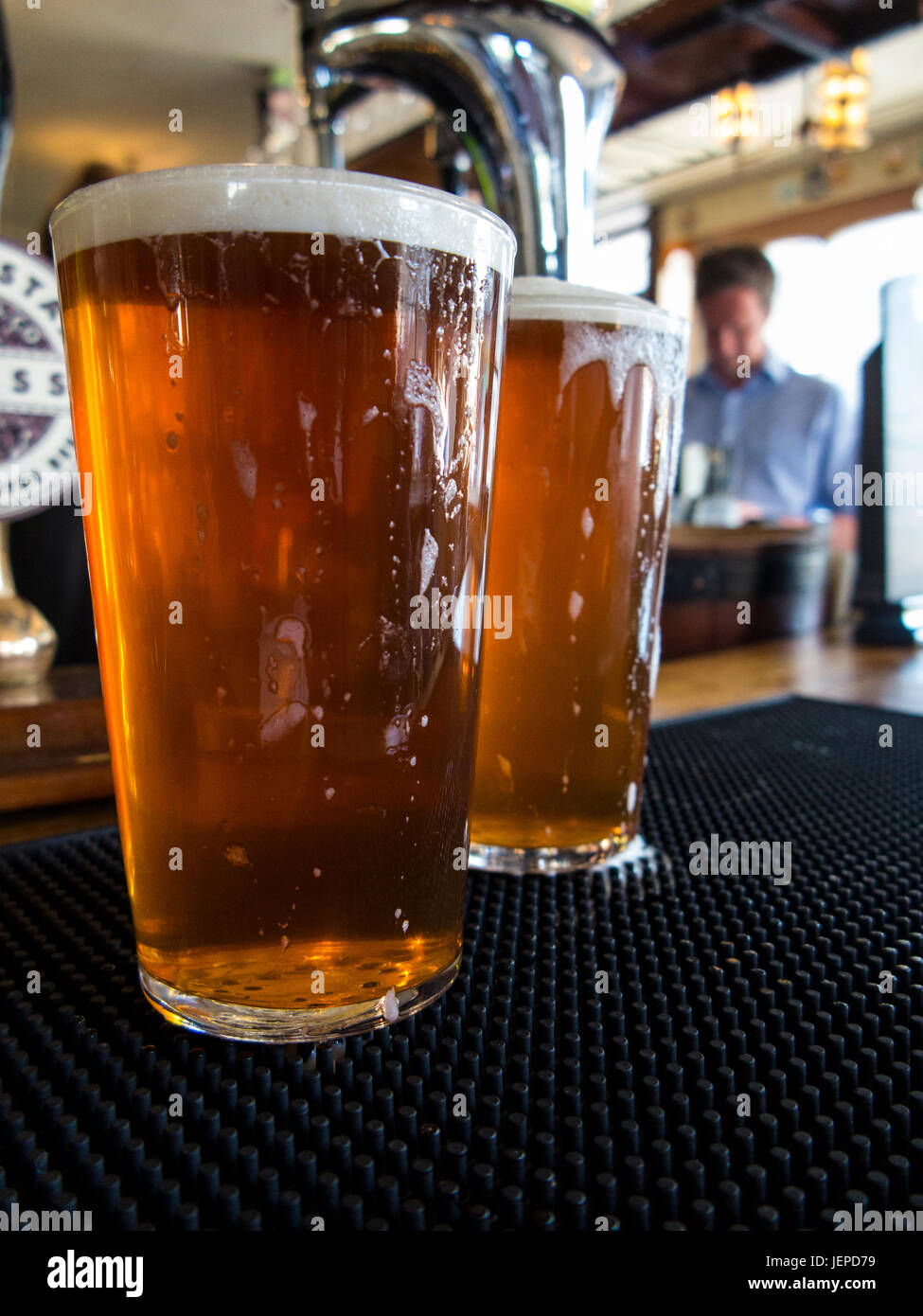 TWO PINTS OF BITTER AWAIT DRINKING IN A LONDON PUB - Stock Image