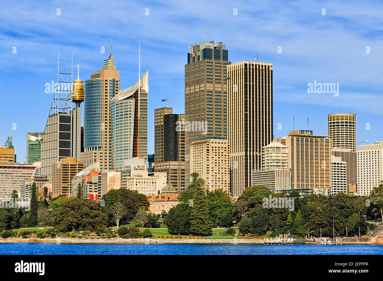 Sydney city CBD high-rise towers over Royal botanic gardens on a bright sunny day. - Stock Image
