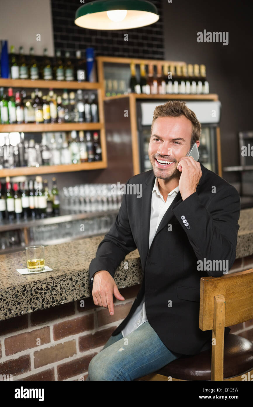 Handsome man having a phone call - Stock Image