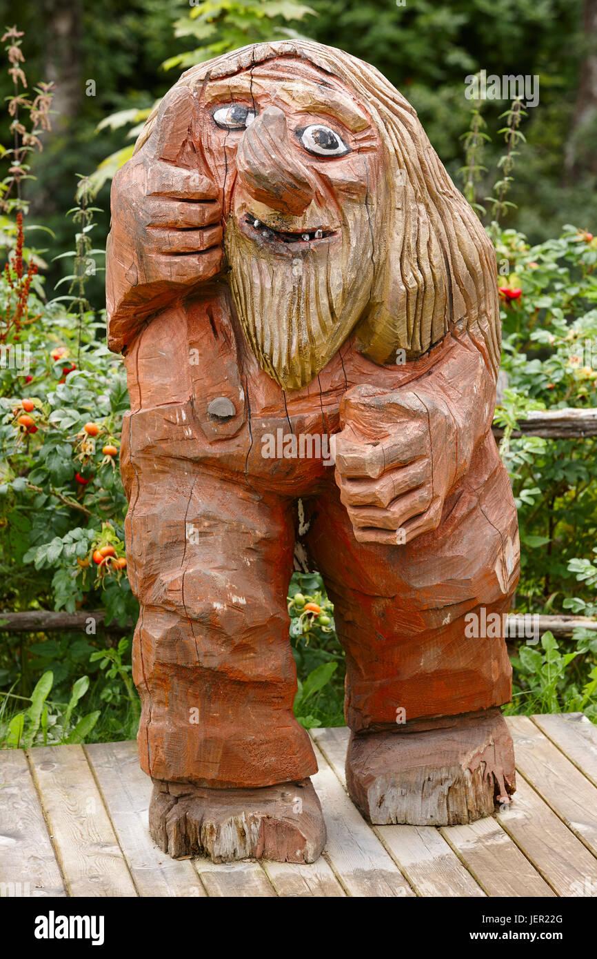 Norwegian carved wooden troll. Scandinavian folklore. Norway. Vertical - Stock Image