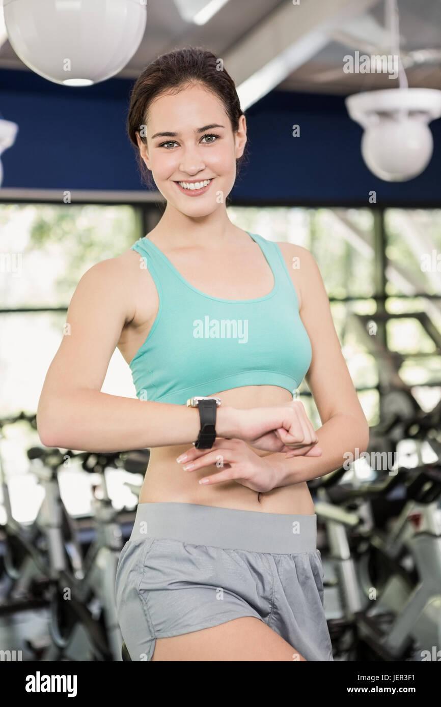 Woman using smart watch - Stock Image