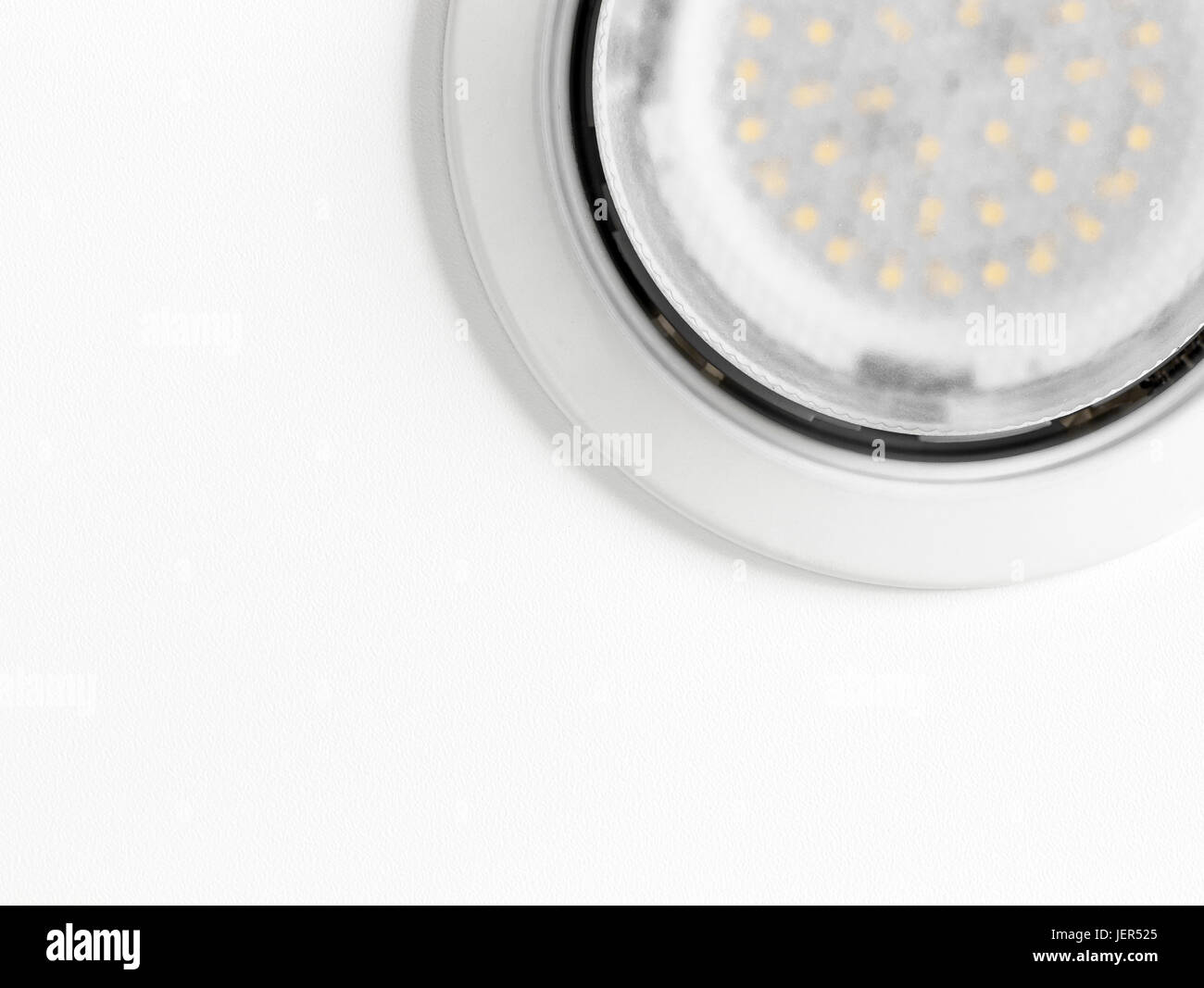 Recessed ceiling LED lamp on white ceiling closeup. - Stock Image