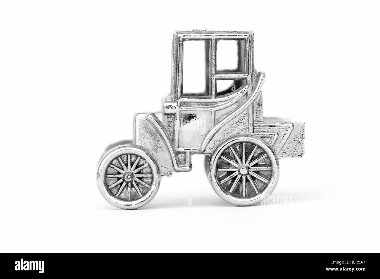 Metal chrome model vintage car on a white background - Stock Image