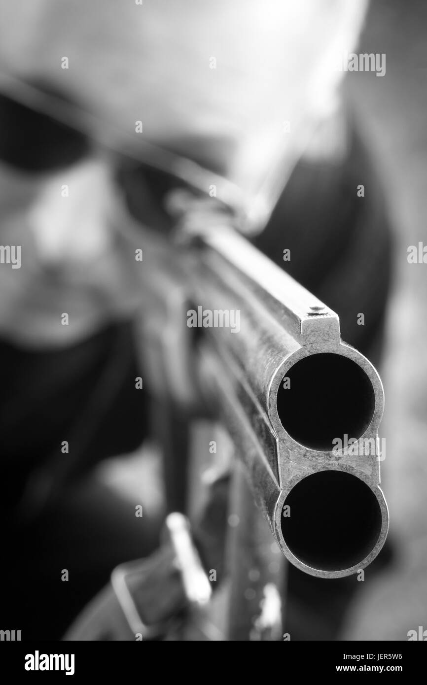 Man takes aim with a hunting rifle closeup. - Stock Image