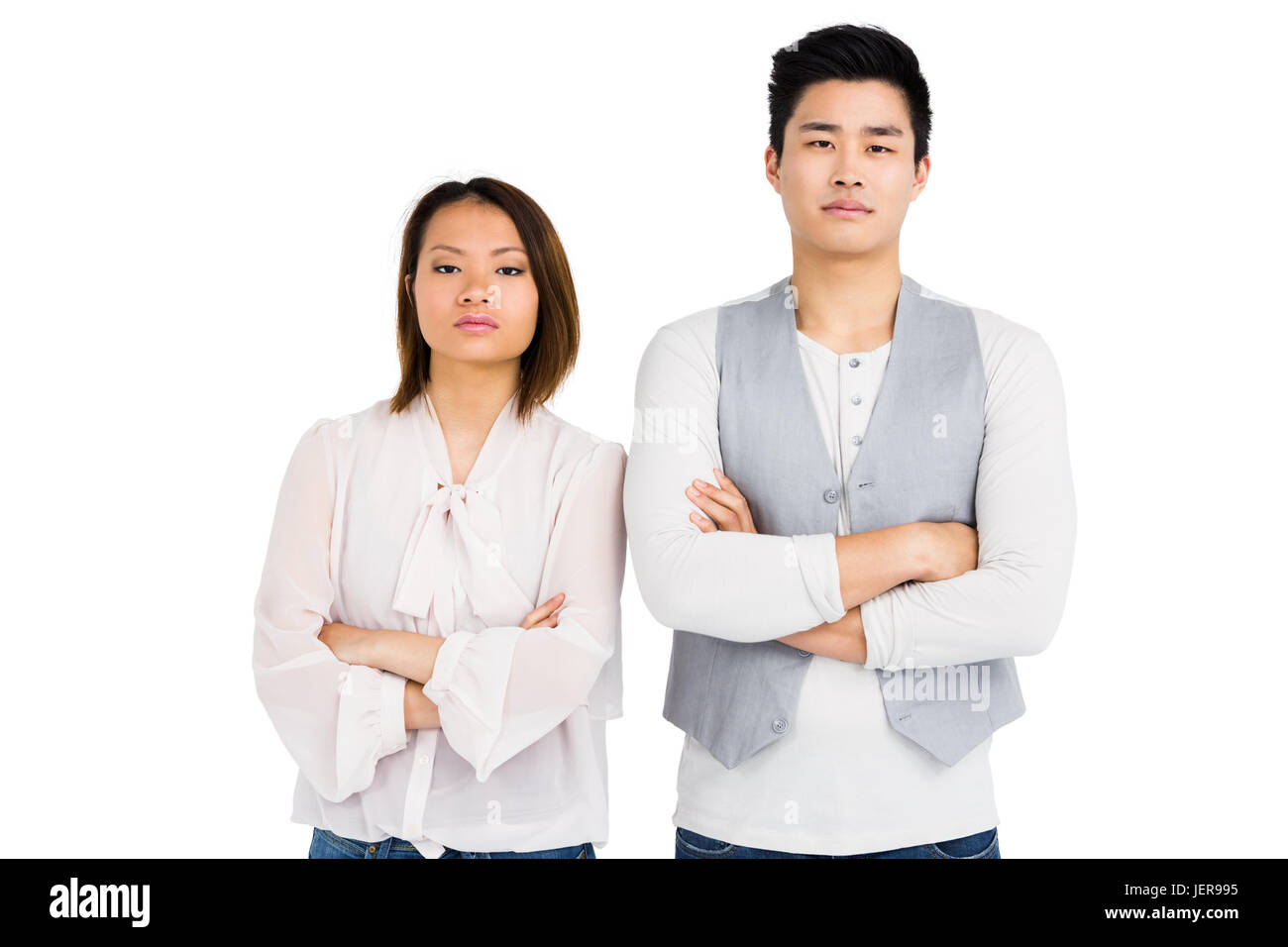 Upset couple standing with arms crossed - Stock Image