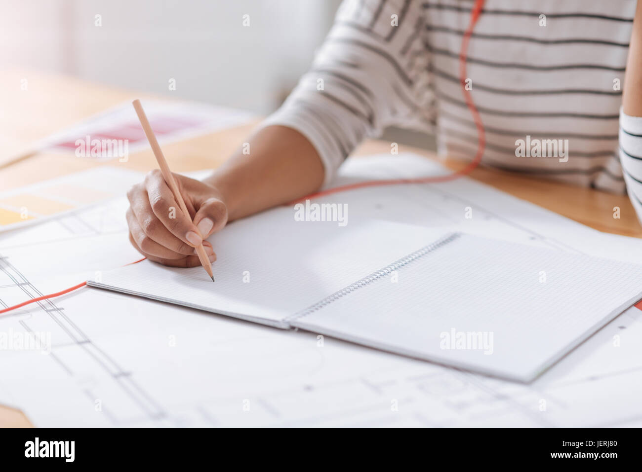 Close up of students notes lying on the table - Stock Image