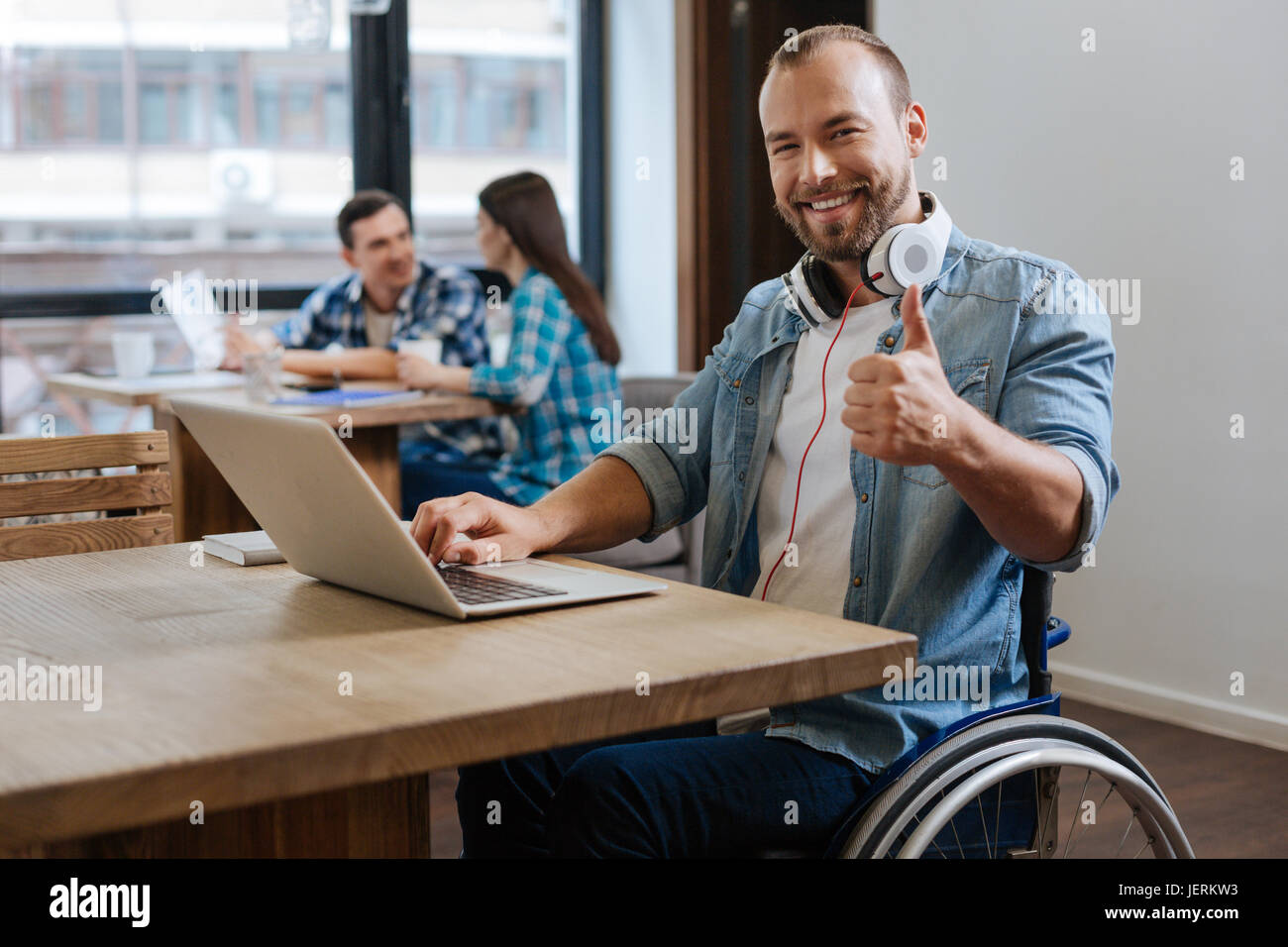 Intrigued productive student visiting new workspace - Stock Image