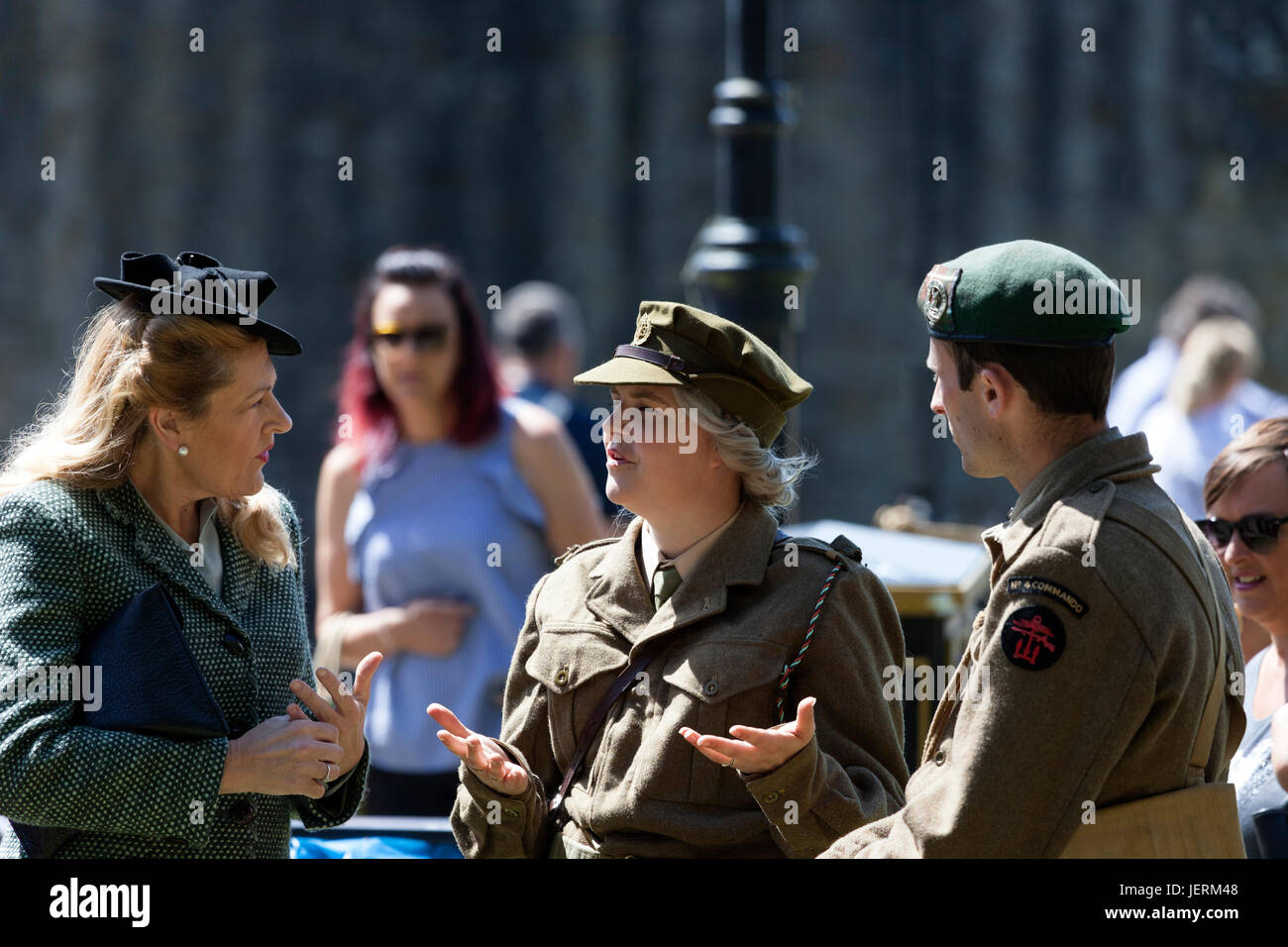 Three People Chatting While Wearing 1940's Style Clothing and Military Uniforms During the 2017 Barnard Castle - Stock Image