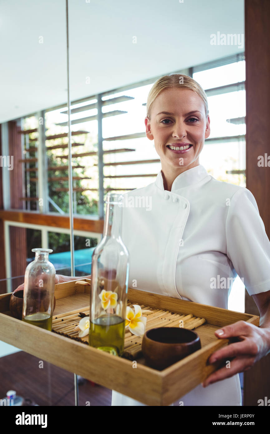 Smiling masseuse holding a tray Stock Photo